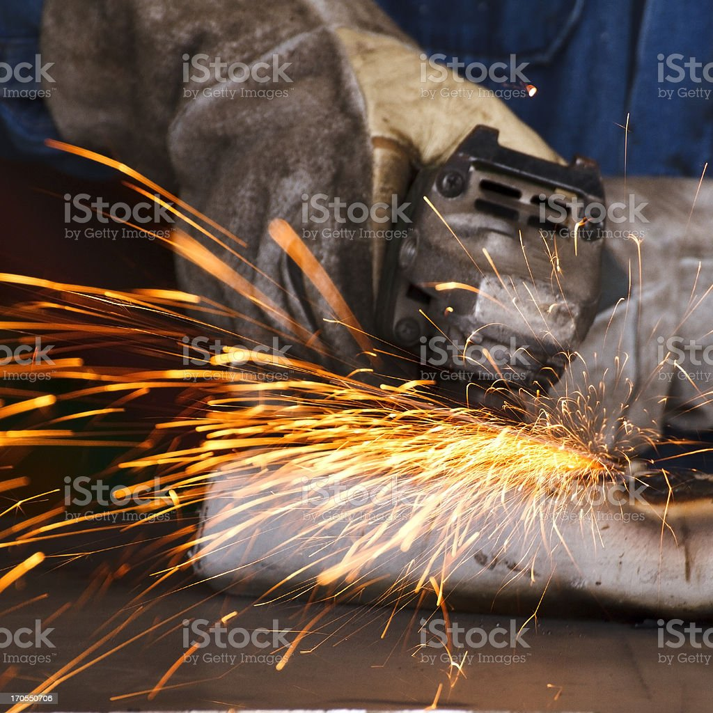 worker grinding steel royalty-free stock photo