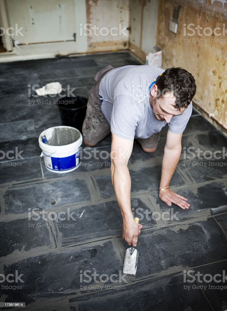 worker grouting slate tile floor royalty-free stock photo