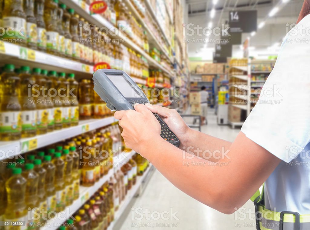 worker hand lady scanning package with warehouse barcode scanner stock photo