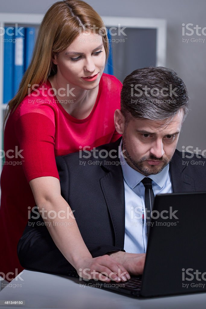 Worker harassed by female chief stock photo