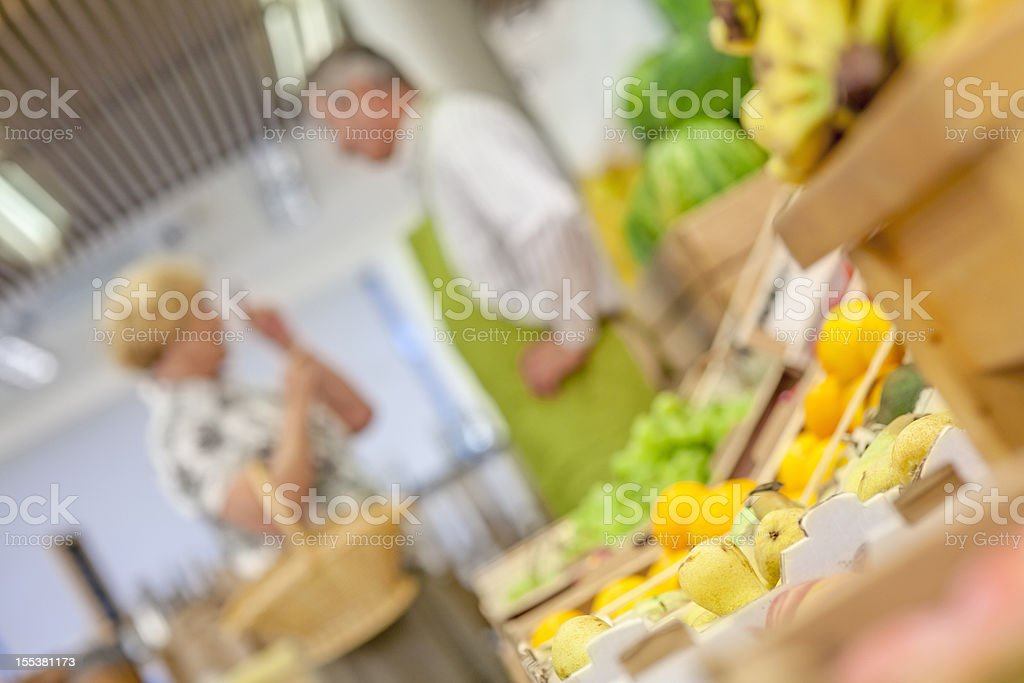 Worker Help Choossing The Right Produce royalty-free stock photo