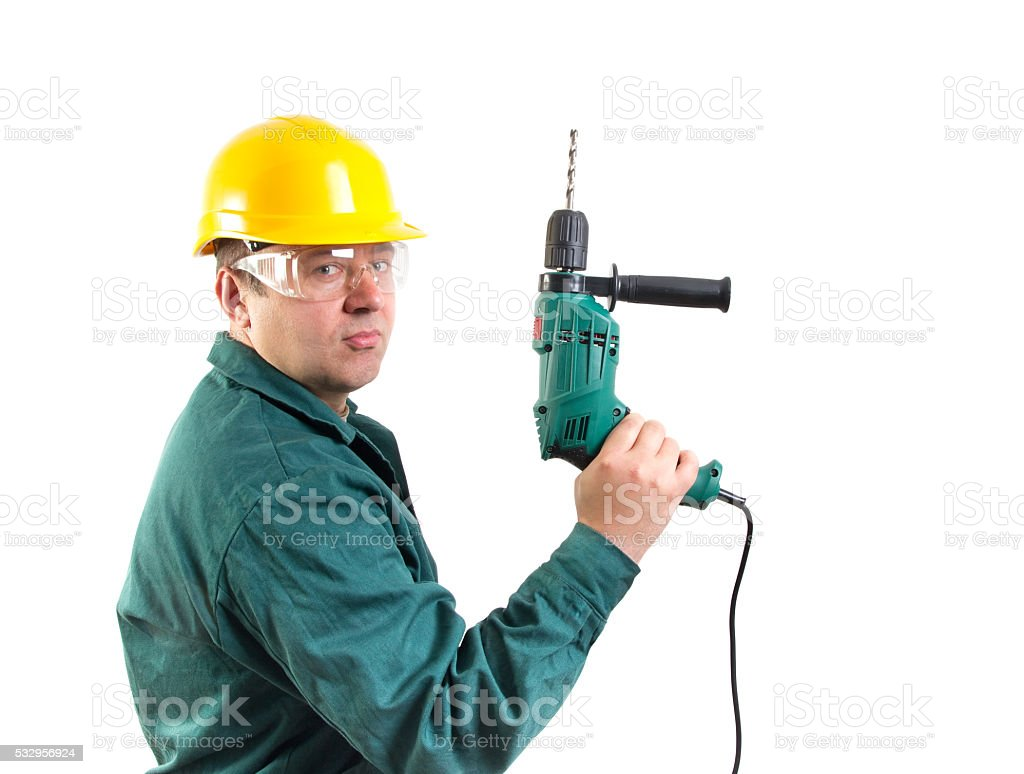 worker hold drill as a gun, clipping path included stock photo