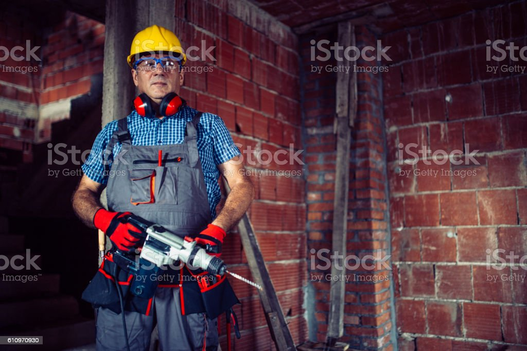 Worker holding a drill stock photo