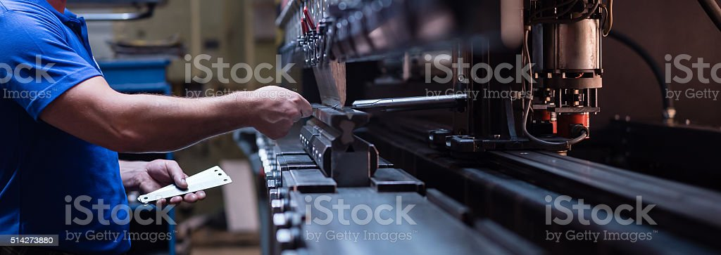 worker holding a metal plate stock photo