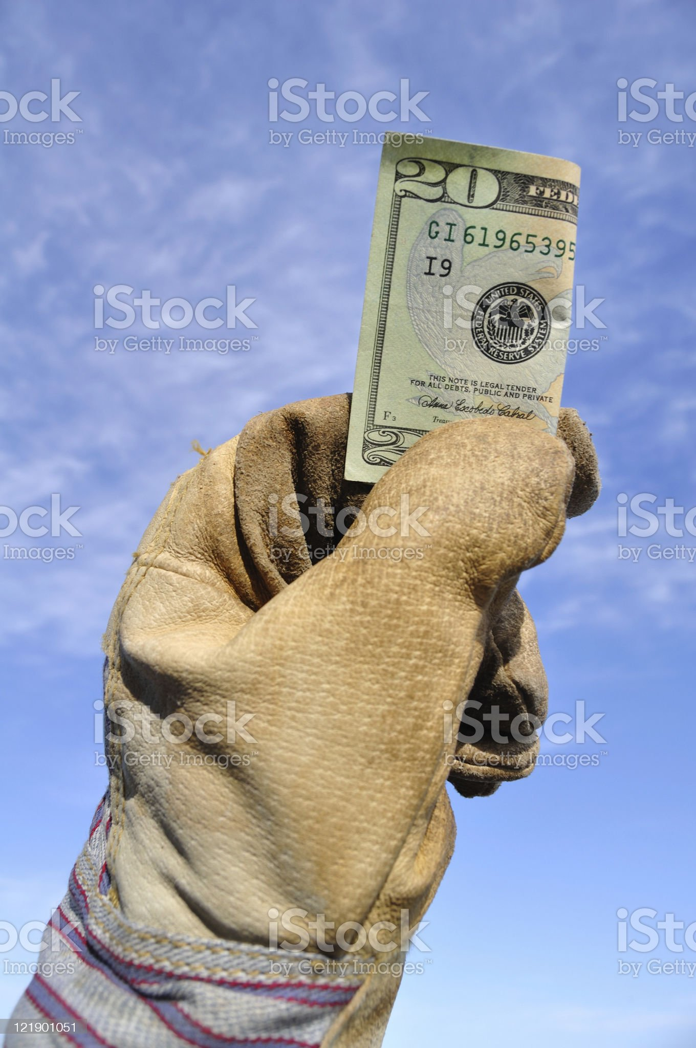 Worker Holding a Twenty Dollar Bill royalty-free stock photo