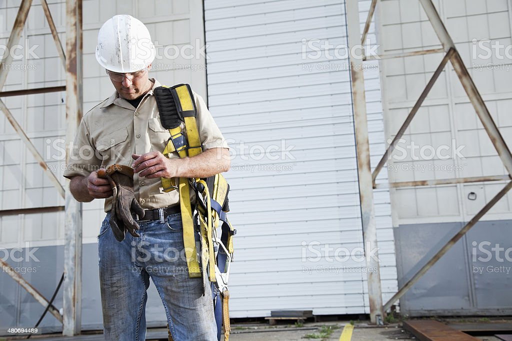 Worker holding safety harness stock photo
