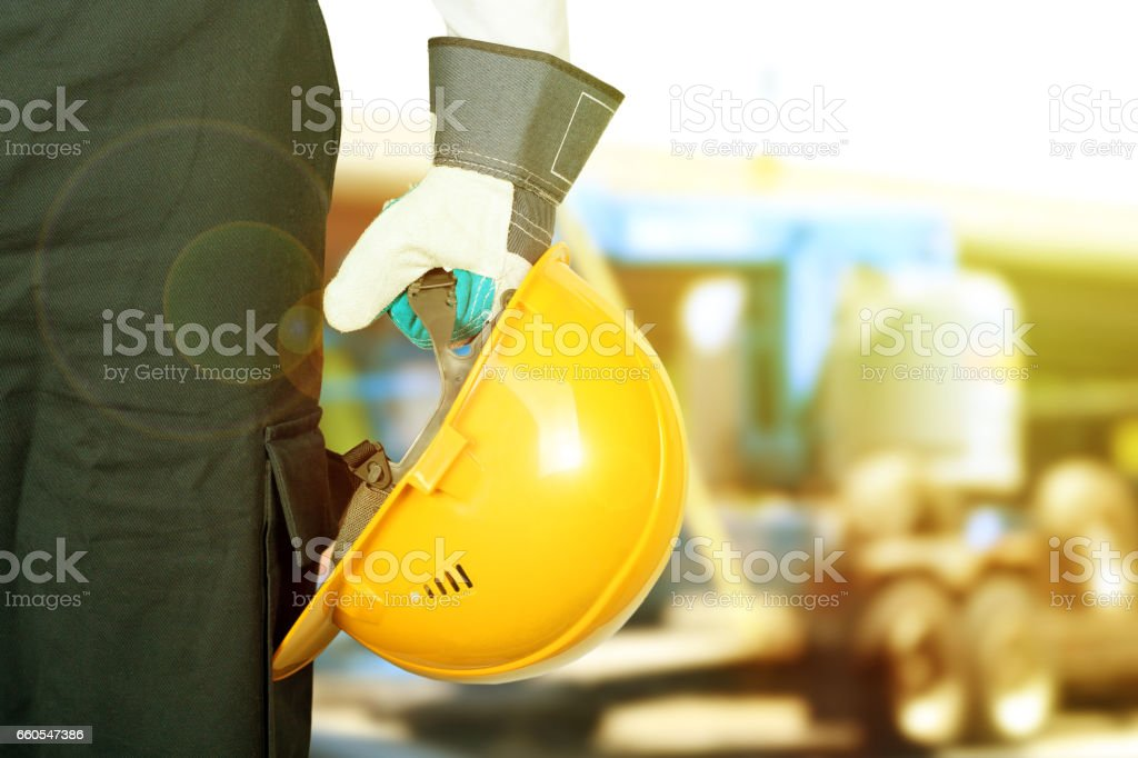 Worker in a construction site with yellow helmet stock photo