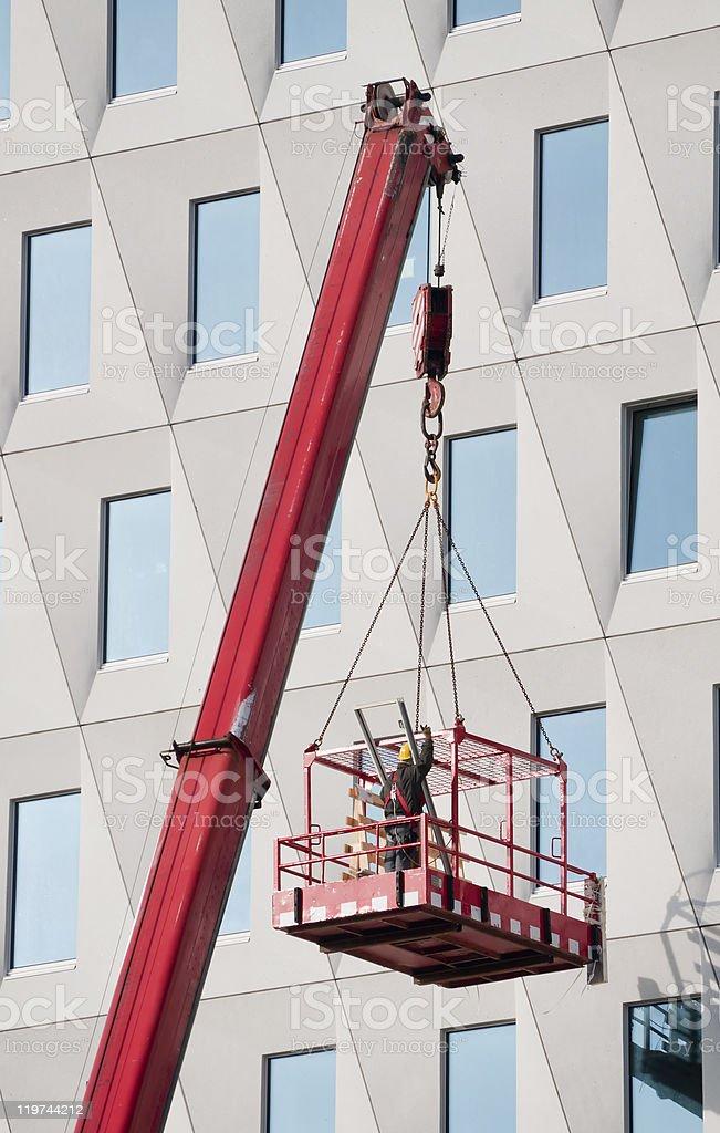 Worker in a hoist basket stock photo