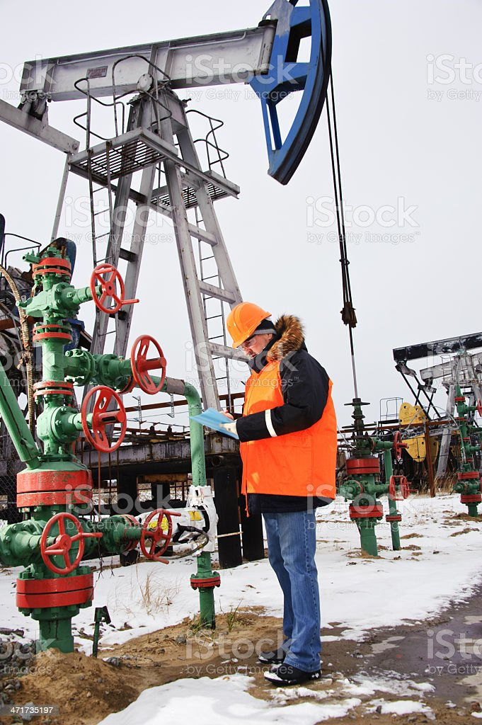 Worker in an oil field. royalty-free stock photo