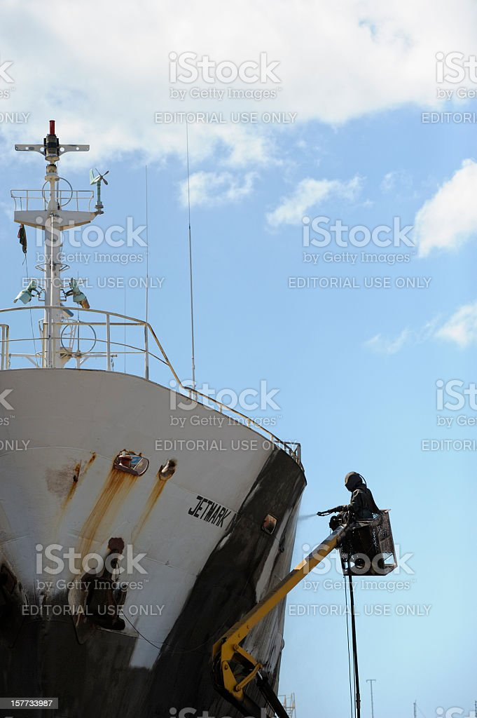 Worker in Cape Town Shipyard stock photo