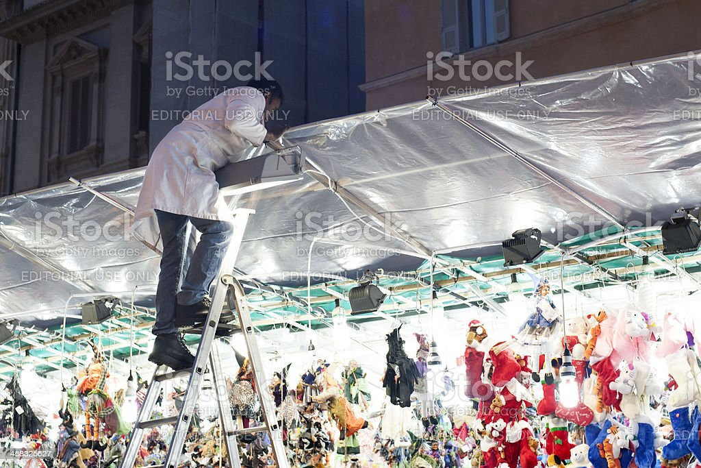 Worker in christmas shop royalty-free stock photo