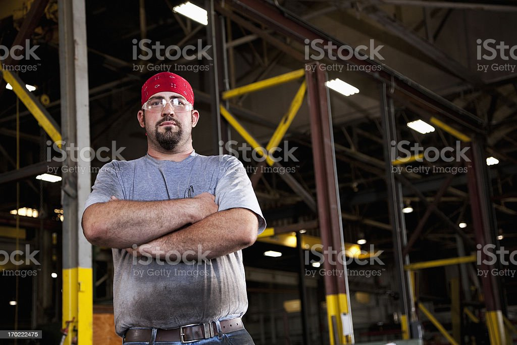 Worker in fabrication shop stock photo