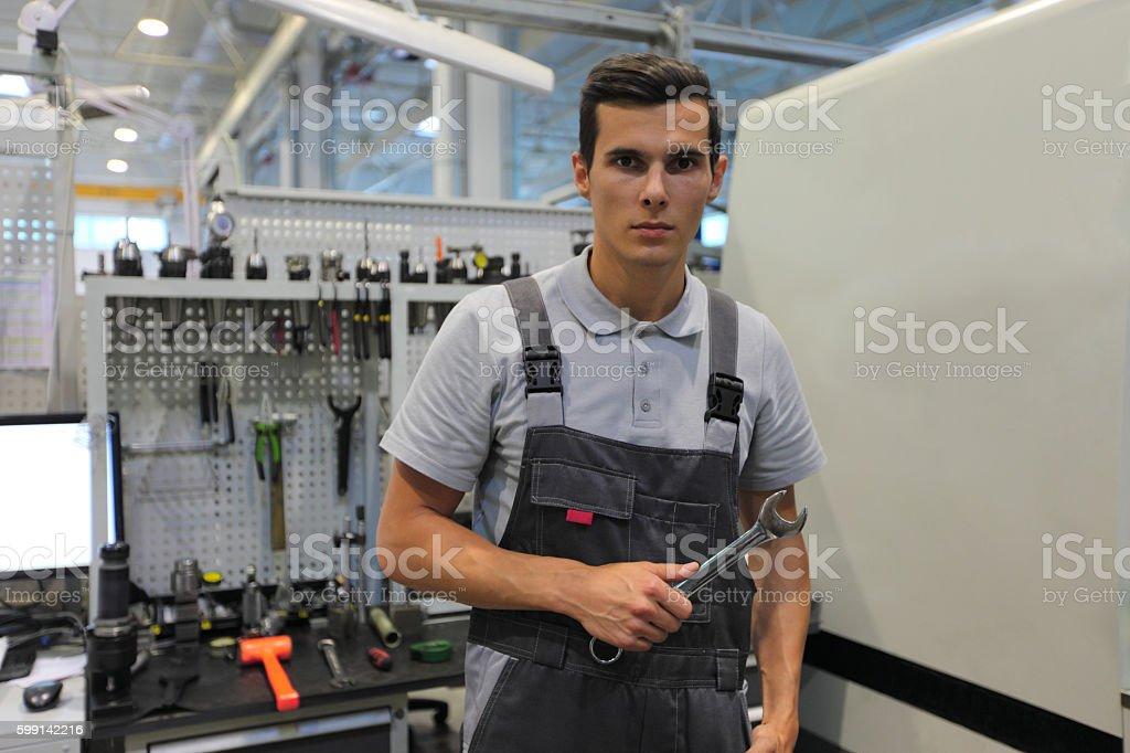 Worker in factory workshop stock photo