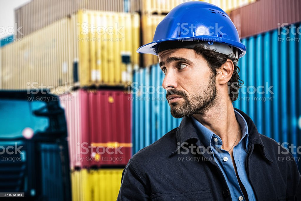 Worker in front of containers stock photo