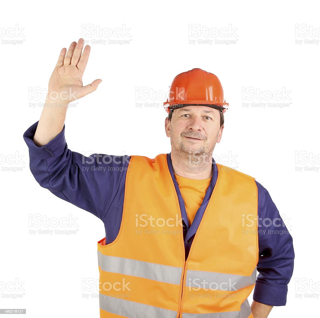 Worker in hard hat with hand up. stock photo