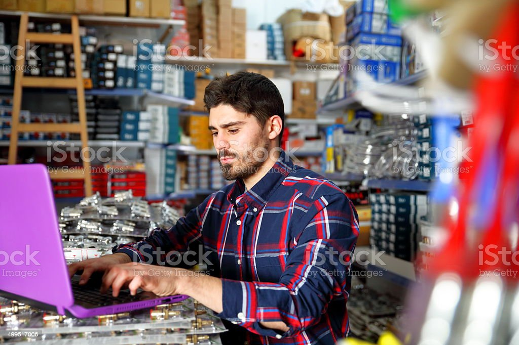Worker in hardware store stock photo