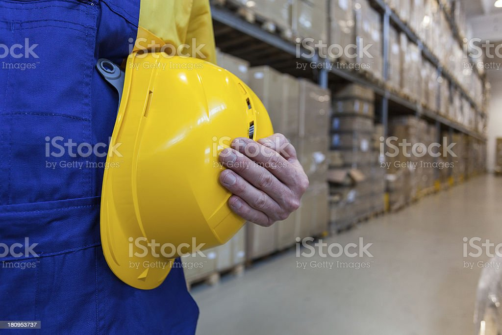 Worker in high bay warehouse royalty-free stock photo