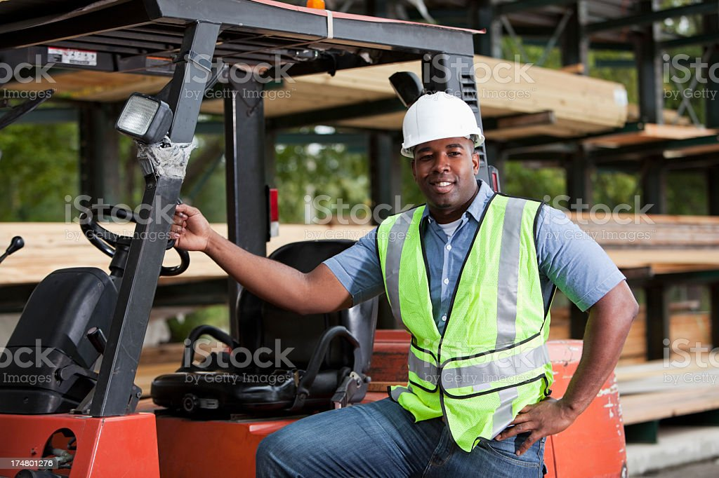 Worker in home improvement store stock photo