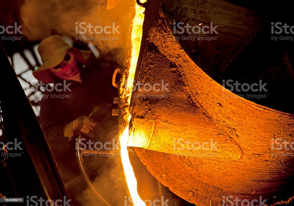 Worker in Iron Foundry stock photo