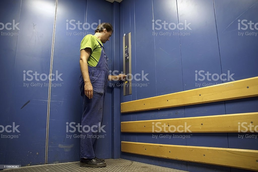 worker in lift 1 stock photo