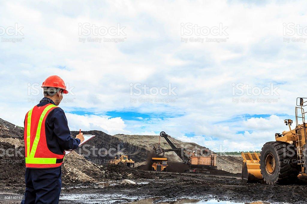 Worker in lignite mine stock photo