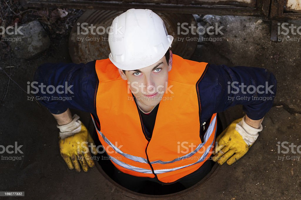 Worker in Manhole royalty-free stock photo
