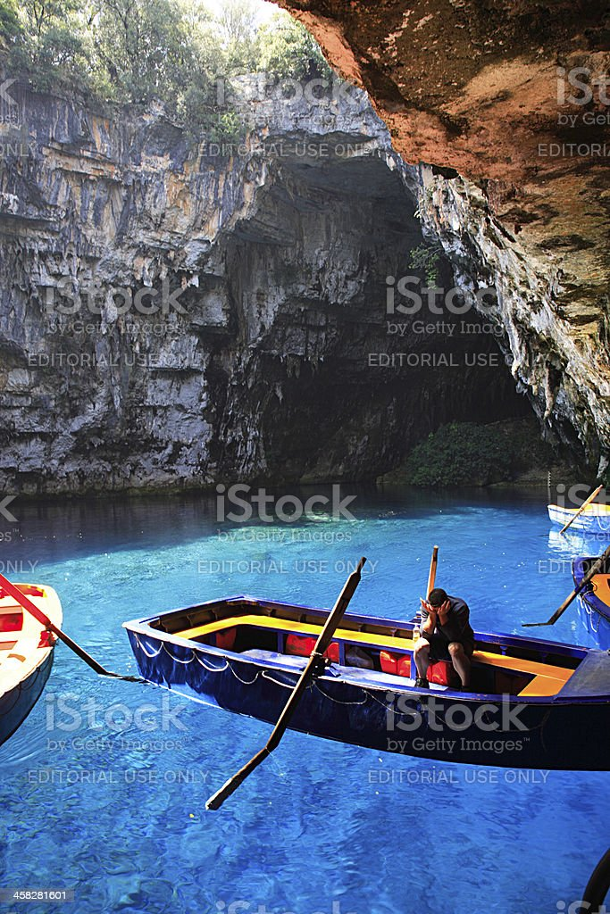 Worker in Melissani Cave royalty-free stock photo
