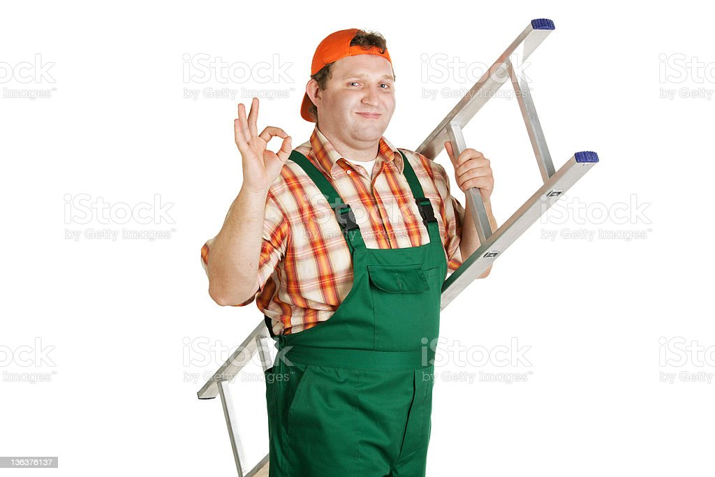 Worker in overalls and a baseball cap royalty-free stock photo