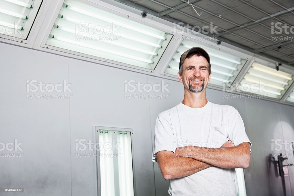 Worker in repair shop royalty-free stock photo