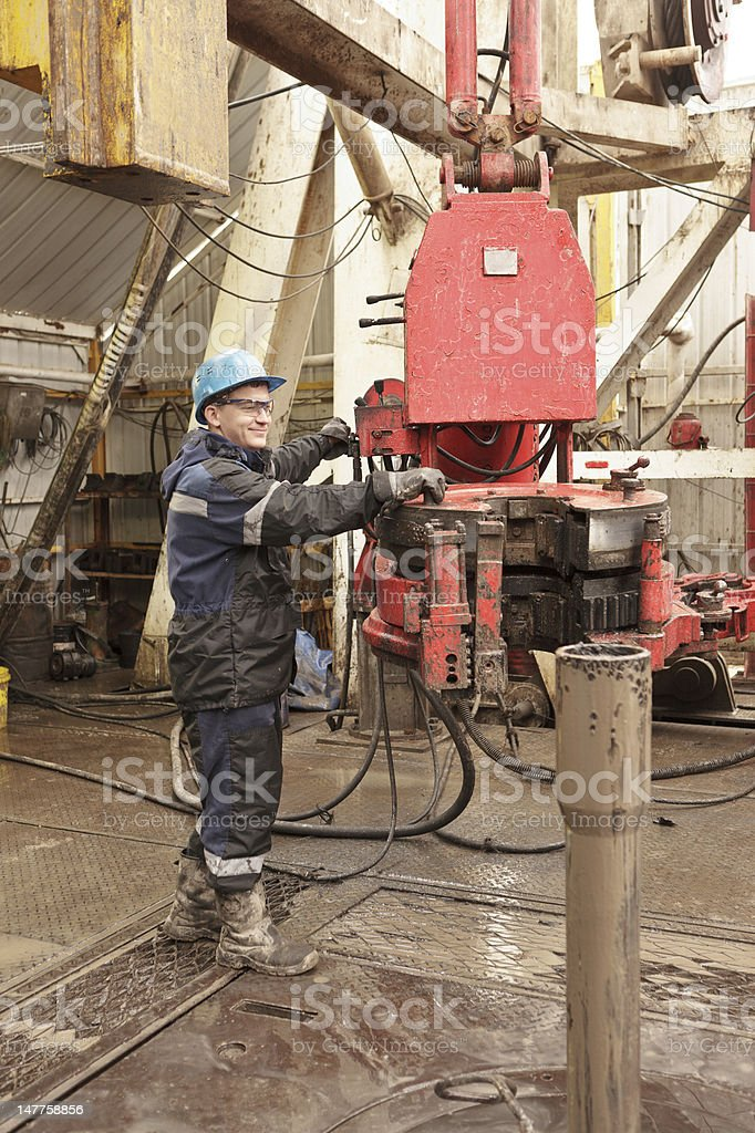 Worker in rig floor royalty-free stock photo