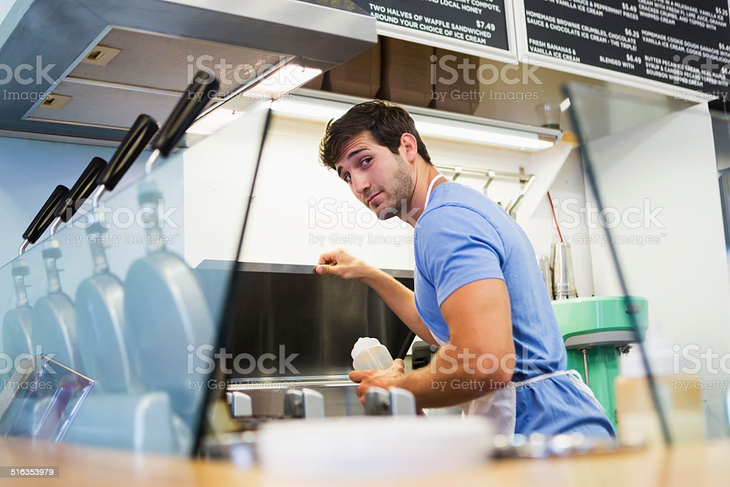 Worker in waffle shop stock photo