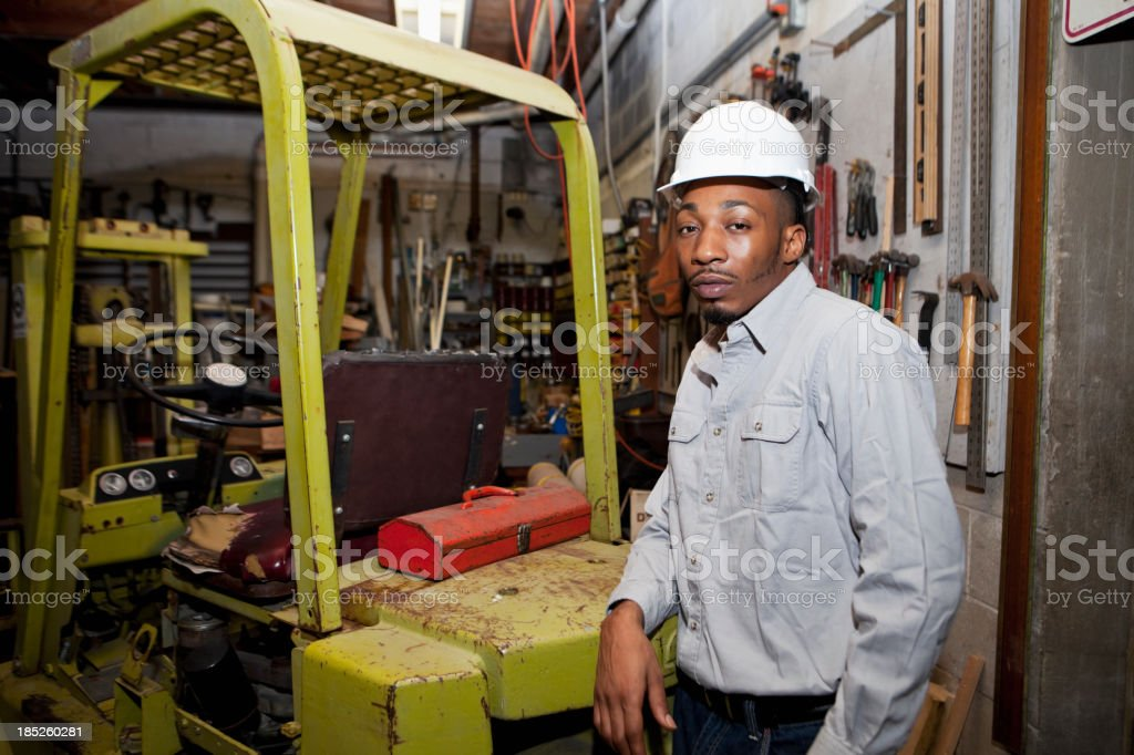 Worker in warehouse by forklift stock photo
