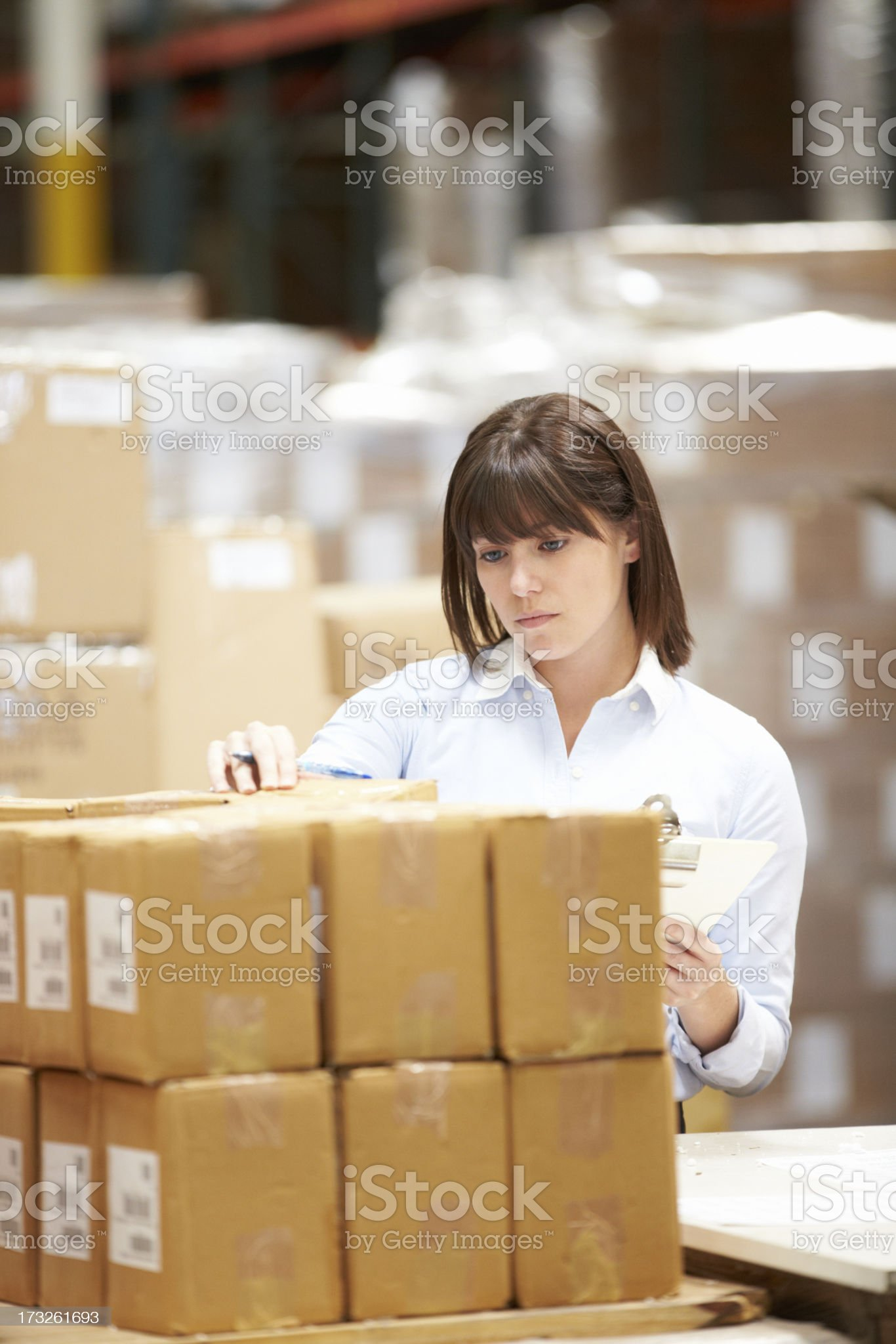 Worker In Warehouse Preparing Goods For Dispatch royalty-free stock photo