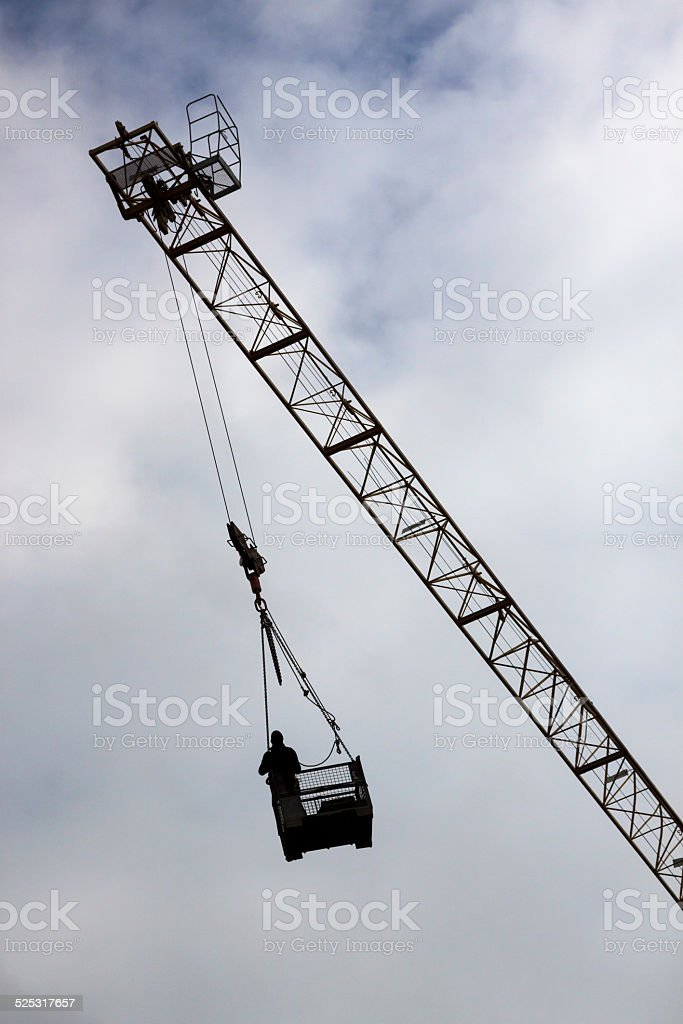 Worker inside of crane basket stock photo