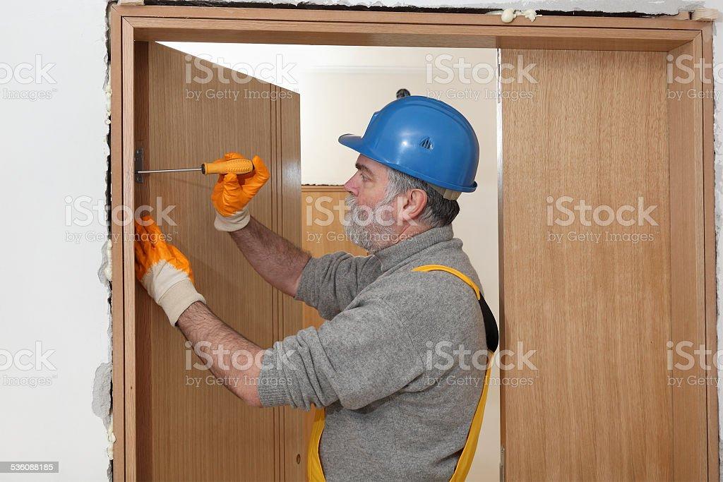 Worker install new door stock photo