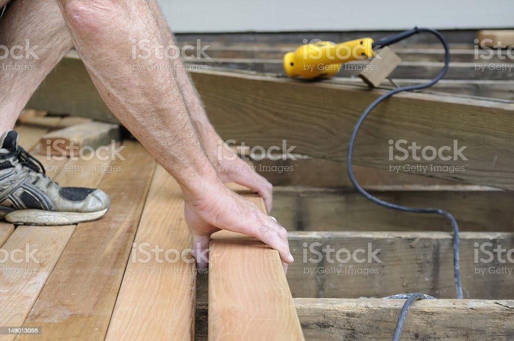 Worker Installing Cedar Deck stock photo