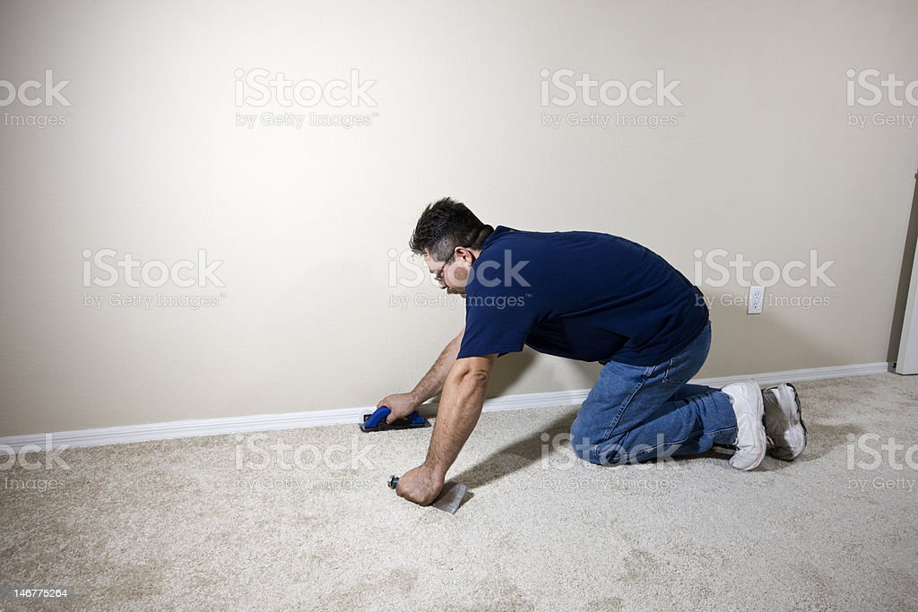 Worker Installing New Carpet stock photo