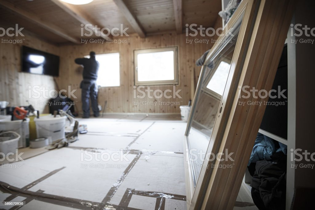 Worker installing new wooden windows stock photo