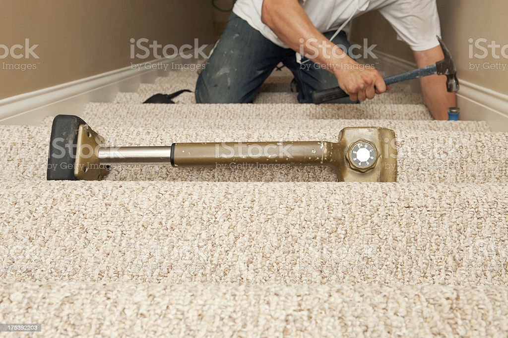 Worker Installing Stair Carpet stock photo