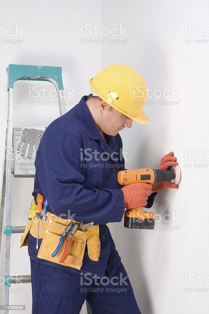 Worker installing wall socket royalty-free stock photo
