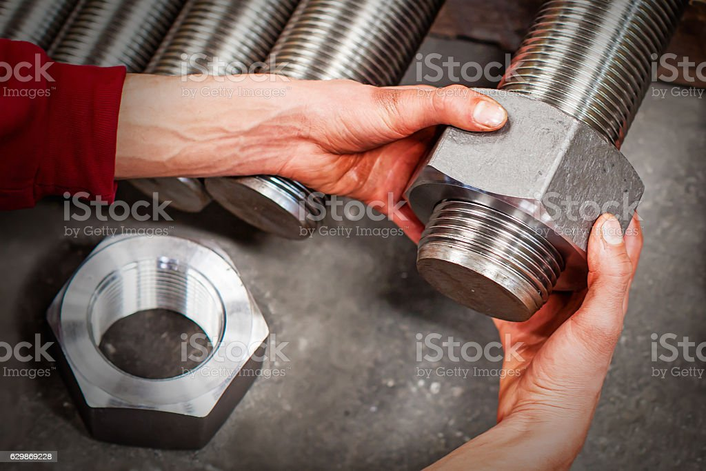 Worker is checking machine parts stock photo
