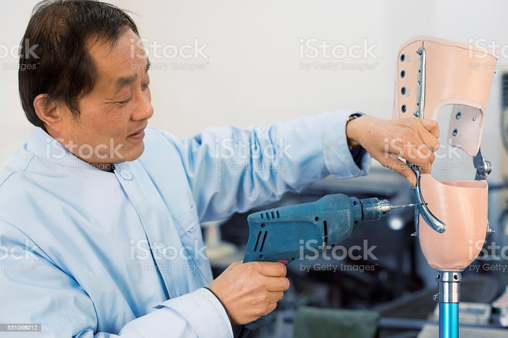 worker is Repairing a prosthetic stock photo