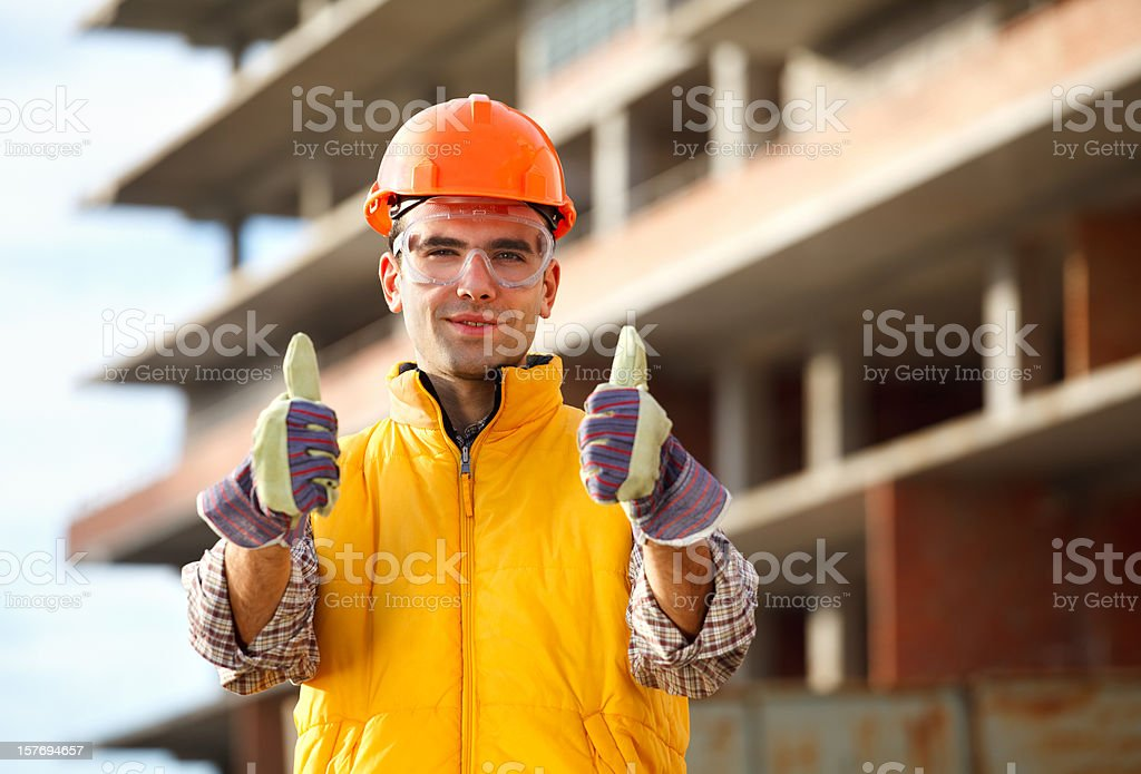 Worker is showing thumb up royalty-free stock photo