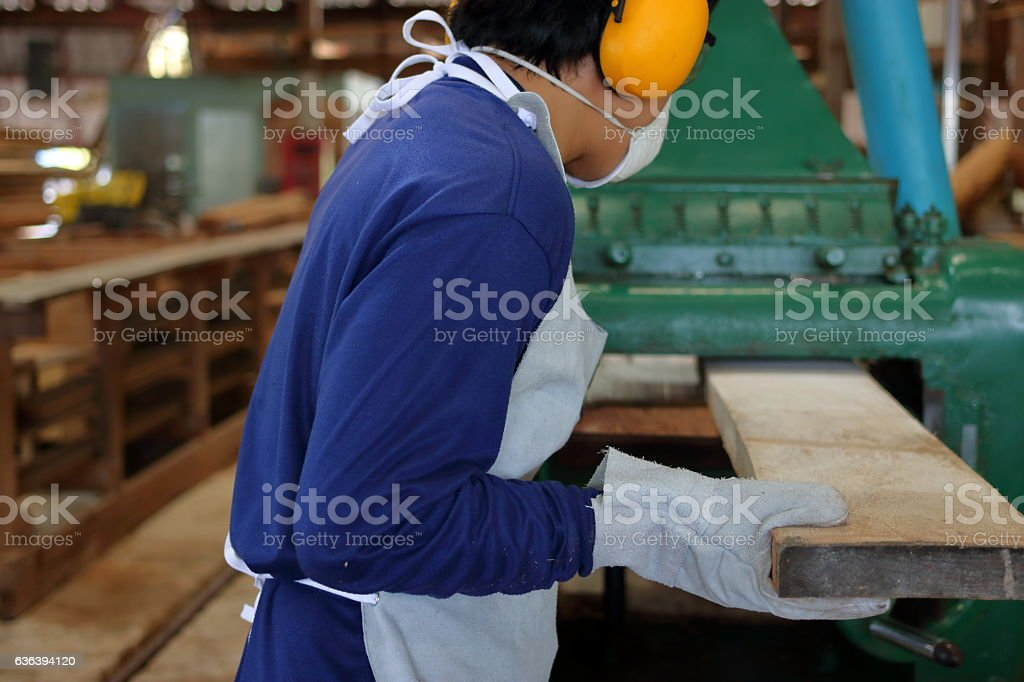 Worker is working with planing of wood machine stock photo