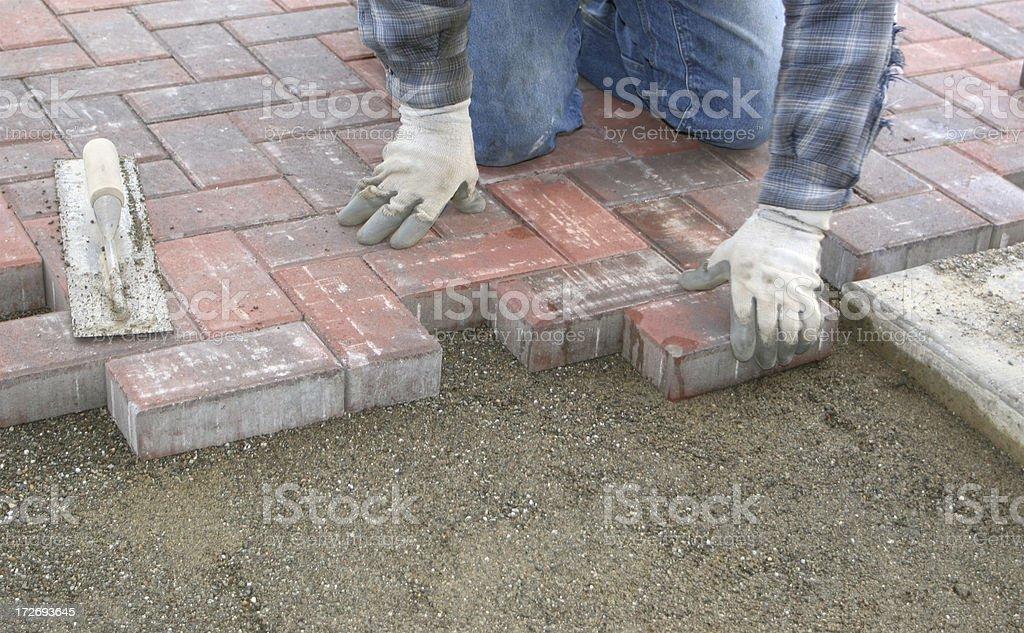 Worker Laying New Brick Sidewalk In Pattern royalty-free stock photo