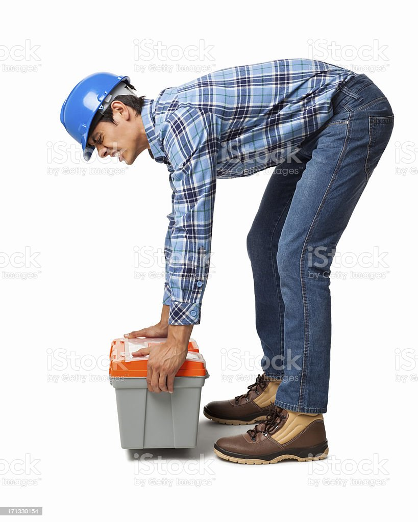 Worker Lifting Heavy Toolbox - Isolated stock photo