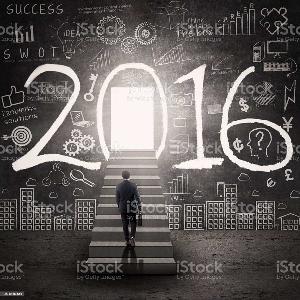 Worker looking at the door to future with numbers 2016 stock photo