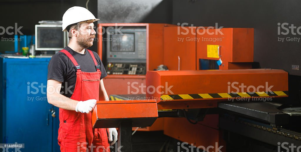 worker looking in the distance stock photo