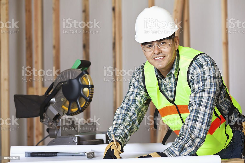 Worker looking up at construction site royalty-free stock photo