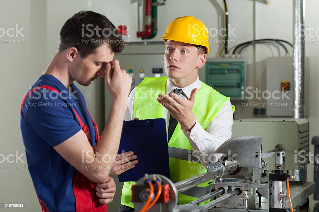 Worker made a mistake in a factory stock photo